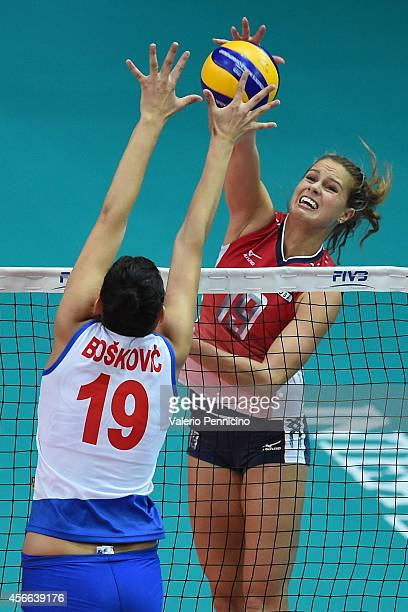 Kelsey Robinson of USA spikes as Tijana Boskovic of Serbia blocks during the FIVB Women's World Championship pool F match between Serbia v USA on...