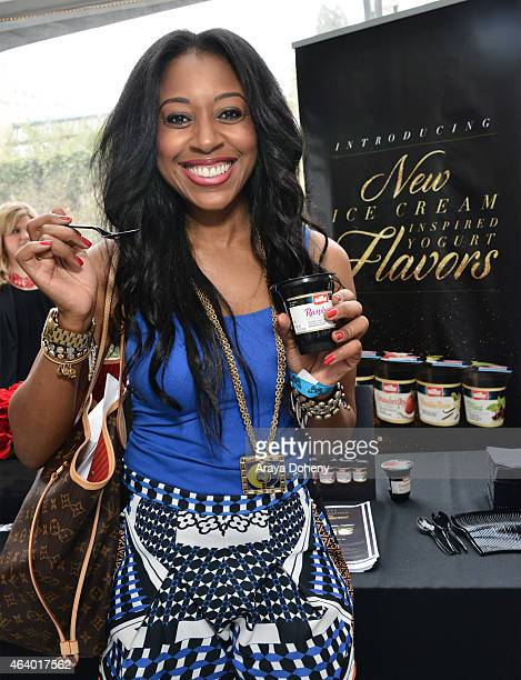 HOLLYWOOD CA FEBRUARY Kelsey Scott indulges in new Muller Raspberry Chocolate Chip ice cream inspired yogurt at the Oscars Celebrity Style Lounge in...