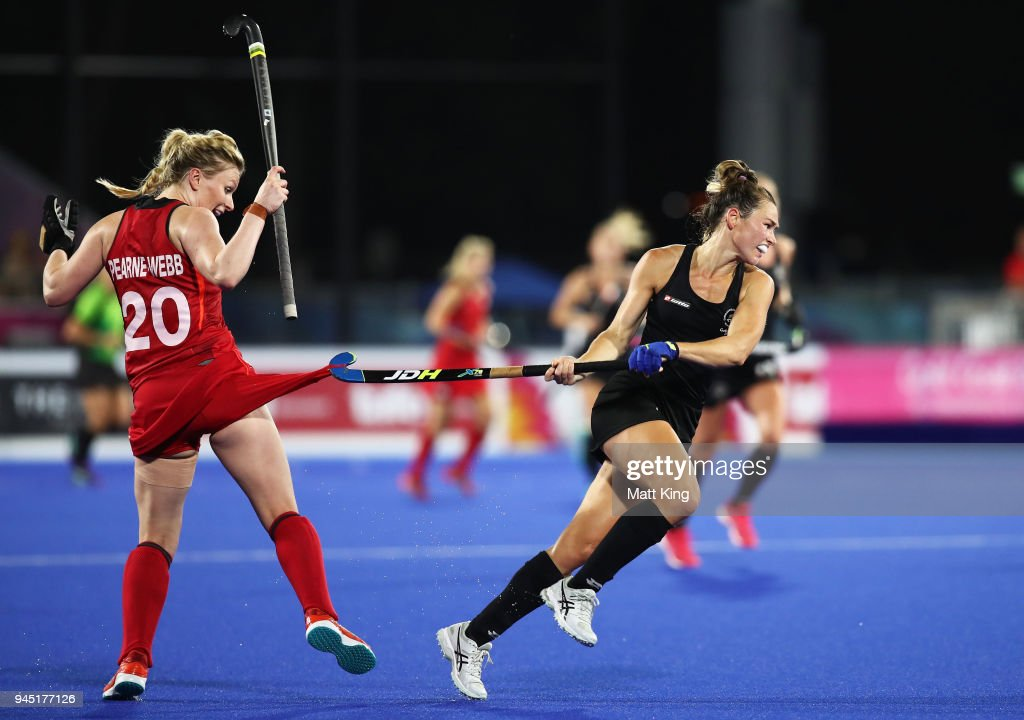 Kelsey Smith of New Zealand gets her stick caught on the shorts of Hollie Pearne-Webb of England during Women's Semi Final Hockey match between England and New Zealand on day eight of the Gold Coast 2018 Commonwealth Games at Gold Coast Hockey Centre on April 12, 2018 on the Gold Coast, Australia.