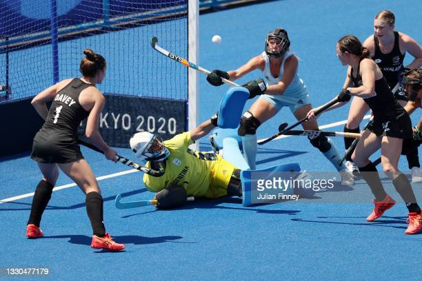 Kelsey Smith of Team New Zealand scores a goal on Maria Belen Succi of Team Argentina during the Women's Pool B match on day two of the Tokyo 2020...
