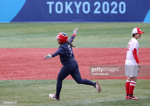 Kelsey Stewart of Team United States celebrates while rounding second base after hitting a walk-off home run in the seventh inning as Mana Atsumi of...