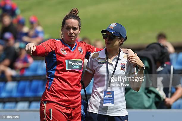 Kelsey Wys of the Jets is carried off injured during the round three WLeague match between the Newcastle Jets and Perth Glory at Hunter Stadium on...