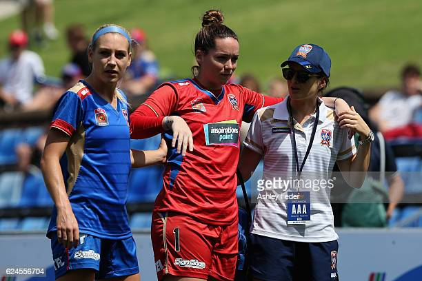 Kelsey Wys of the Jets is walked off with team mate Megan Oyster during the round three WLeague match between the Newcastle Jets and Perth Glory at...