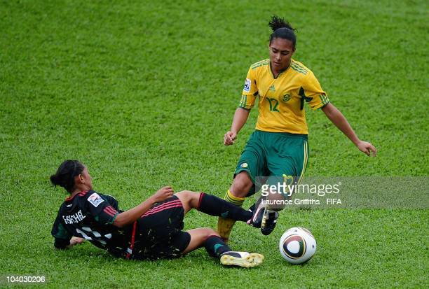 Kelso Peskin of South Africa battles with Cristina Ferral of Mexico during the FIFA U17 Women's World Cup Group B match between Mexico and South...