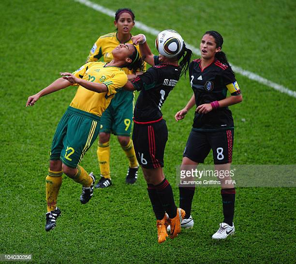Kelso Peskin of South Africa battles with Mariel Gutierrez of Mexico during the FIFA U17 Women's World Cup Group B match between Mexico and South...