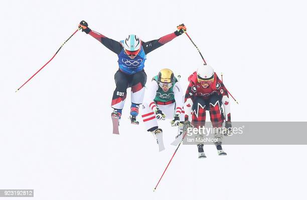 Kelsy Serwa of Canada Sanna Luedi of Switzerland and Katin Ofner of Austria compete in the Quarterfinals of the Women's Ski Cross Final during day...