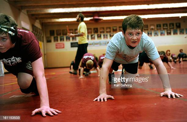 Kelton Good age 14 right guts out a demanding series of exercises near the end of Wednesday night's workout The Parker Sons of Thunder elite...