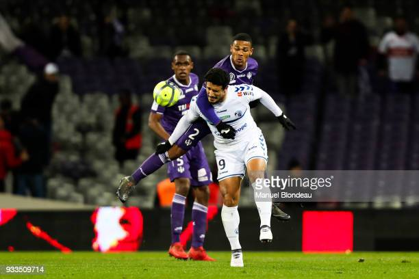 Kelvin Amian of Toulouse and Idriss Saadi of Strasbourg during the Ligue 1 match between Toulouse and Strasbourg at Stadium Municipal on March 17...