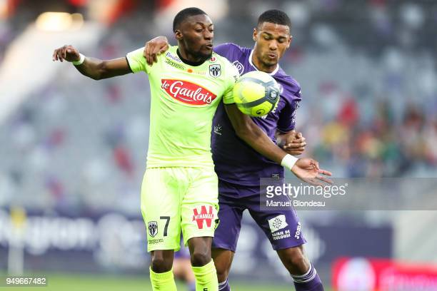 Kelvin Amian of Toulouse and Karl Toko Ekambi of Angers during the Ligue 1 match between Toulouse and Angers SCO at Stadium Municipal on April 21...