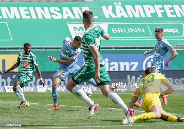 Kelvin Arase of SK Rapid Wien, Raffael Behounek of WSG Tirol, Ercan Kara of SK Rapid Wien battle for the ball during the tipico Bundesliga match...