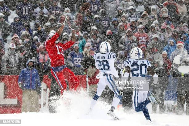 Kelvin Benjamin of the Buffalo Bills attempts to catch a ball as Chris Milton of the Indianapolis Colts and Darius Butler of the Indianapolis Colts...