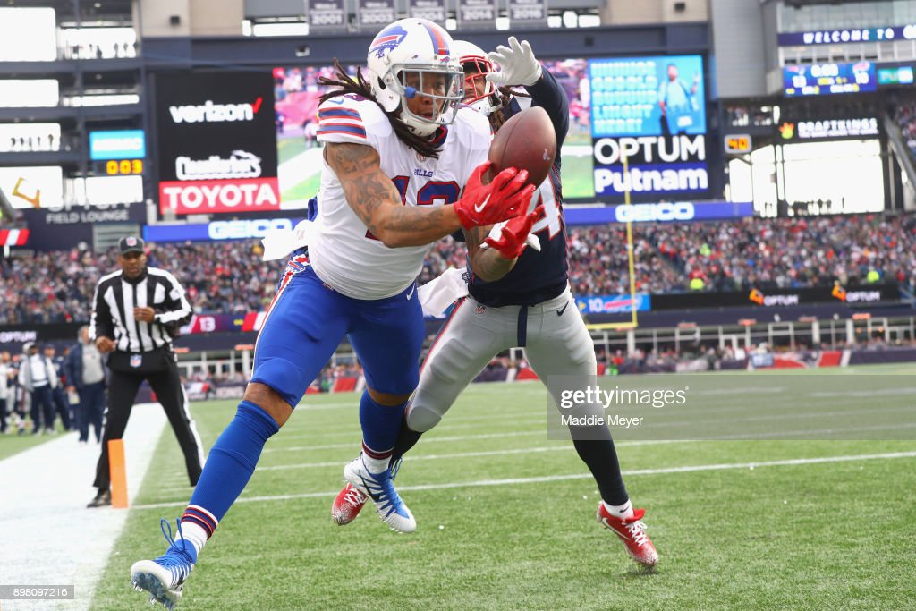 Kelvin Benjamin #13 of the Buffalo Bills catches a touchdown pass as he is defended by Stephon Gilmore #24 of the New England Patriots during the quarter of a game against the Buffalo Bills at Gillette Stadium on December 24, 2017 in Foxboro, Massachusetts. The touchdown was reversed after an official review.