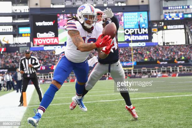 Kelvin Benjamin of the Buffalo Bills catches a touchdown pass as he is defended by Stephon Gilmore of the New England Patriots during the quarter of...