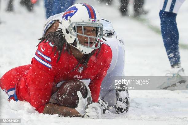 Kelvin Benjamin of the Buffalo Bills catches the ball as Kenny Moore of the Indianapolis Colts attempts to defend him during the second quarter on...