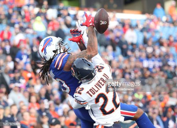 Kelvin Benjamin of the Buffalo Bills drops a pass in the end zone in the fourth quarter during NFL game action as he is hit by Kevin Toliver II of...