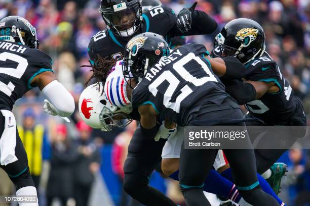 Kelvin Benjamin of the Buffalo Bills is brought down by Jacksonville Jaguars during the first quarter at New Era Field on November 25, 2018 in...