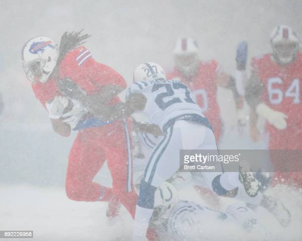 Kelvin Benjamin of the Buffalo Bills is brought down by Nate Hairston and Quincy Wilson of the Indianapolis Colts during the first quarter at New Era...