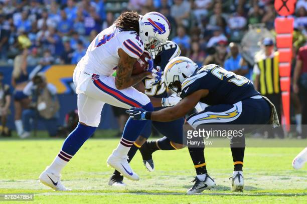 Kelvin Benjamin of the Buffalo Bills is hit and injured by Adrian Phillips of the Los Angeles Chargers during the first quarter of the game at the...