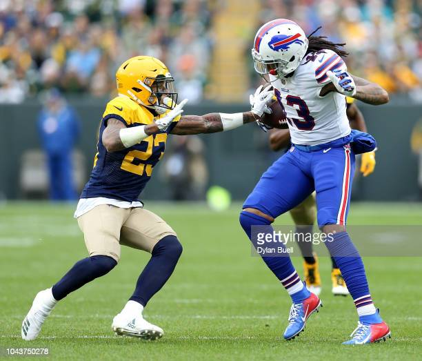 Kelvin Benjamin of the Buffalo Bills is tackled by Jaire Alexander of the Green Bay Packers during the second quarter of a game at Lambeau Field on...