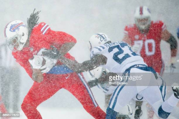 Kelvin Benjamin of the Buffalo Bills is tackled by Nate Hairston of the Indianapolis Colts during the first quarter on December 10 2017 at New Era...