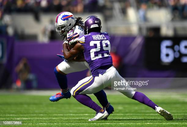 Kelvin Benjamin of the Buffalo Bills is tackled with the ball by Xavier Rhodes of the Minnesota Vikings in the second quarter of the game at US Bank...