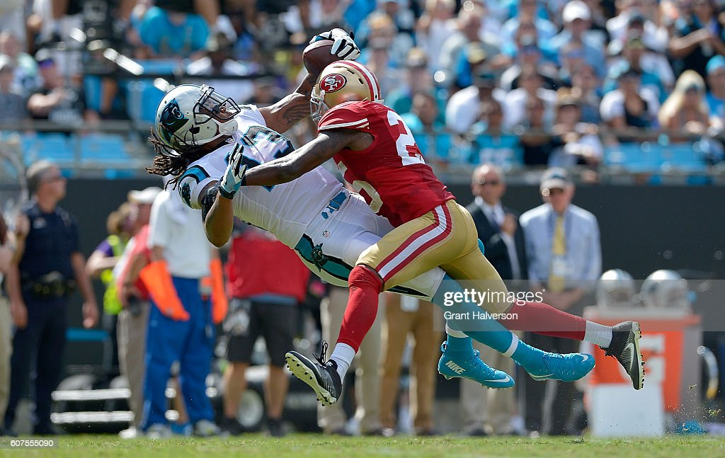Kelvin Benjamin #13 of the Carolina Panthers carches a pass against Jimmie Ward #25 of the San Francisco 49ers in the 3rd quarter during the game at Bank of America Stadium on September 18, 2016 in Charlotte, North Carolina.