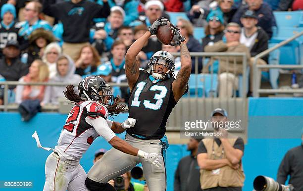 Kelvin Benjamin of the Carolina Panthers catches a touchdown pass against Jalen Collins of the Atlanta Falcons in the 3rd quarter during the game at...