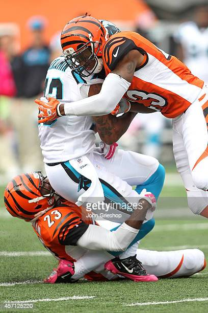 Kelvin Benjamin of the Carolina Panthers is tackled by George Iloka and Terence Newman of the Cincinnati Bengals during the fourth quarter at Paul...