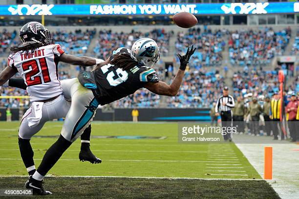 Kelvin Benjamin of the Carolina Panthers makes a 4th quarter touchdown reception against Desmond Trufant of the Atlanta Falcons during their game at...