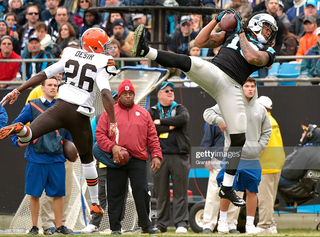 Kelvin Benjamin #13 of the Carolina Panthers makes a catch against Pierre Desir #26 of the Cleveland Browns during their game at Bank of America Stadium on December 21, 2014 in Charlotte, North Carolina.