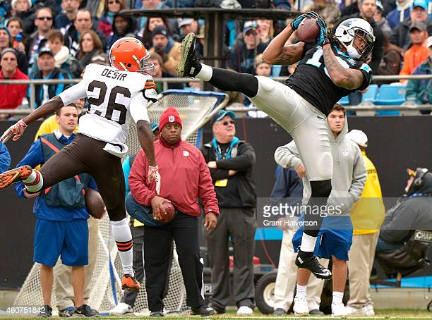 Kelvin Benjamin of the Carolina Panthers makes a catch against Pierre Desir of the Cleveland Browns during their game at Bank of America Stadium on...
