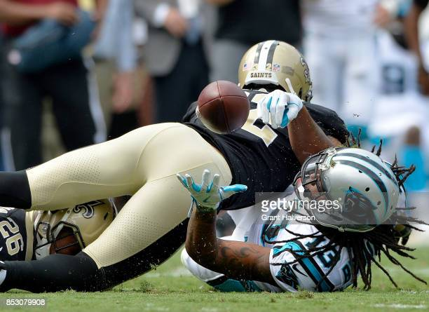 Kelvin Benjamin of the Carolina Panthers makes a juggling catch against PJ Williams of the New Orleans Saints during their game at Bank of America...