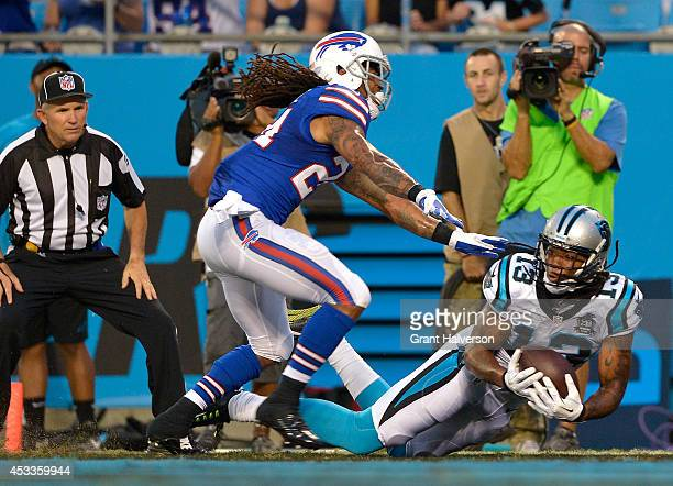 Kelvin Benjamin of the Carolina Panthers makes a touchdown catch as Stephon Gilmore of the Buffalo Bills defends during their game at Bank of America...