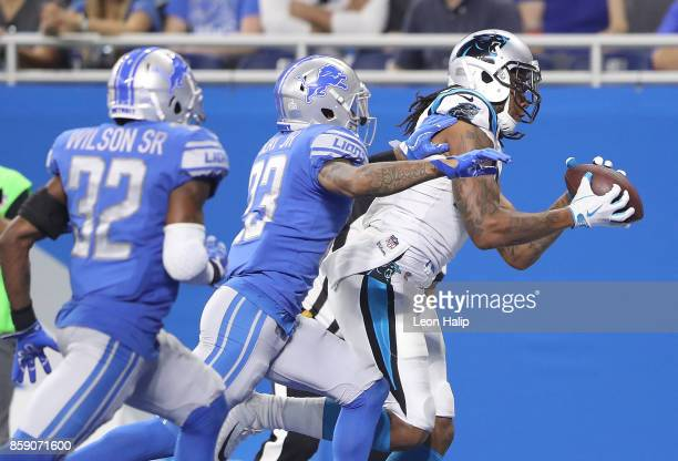 Kelvin Benjamin of the Carolina Panthers makes a touchdown catch against the Darius Slay of the Detroit Lions and Tavon Wilson during the third...