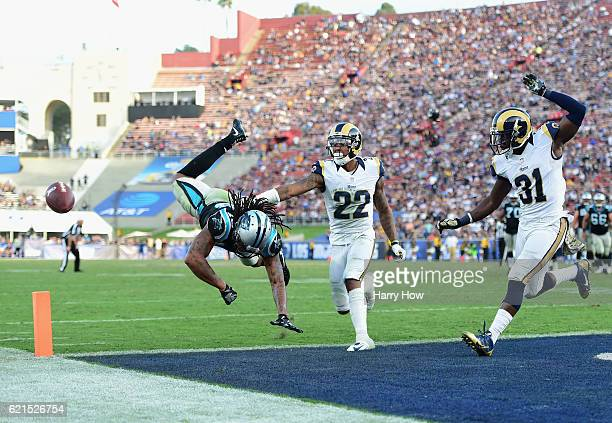 Kelvin Benjamin of the Carolina Panthers misses a catch in front of Trumaine Johnson and Maurice Alexander of the Los Angeles Rams during the fourth...