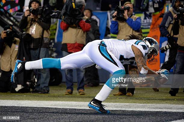 Kelvin Benjamin of the Carolina Panthers scores a 15 yard touchdown thrown by Cam Newton in the fourth quarter against the Seattle Seahawks during...
