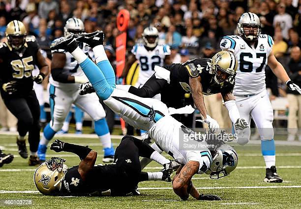 Kelvin Benjamin of the Carolina Panthers scores a touchdown as Pierre Warren of the New Orleans Saints tries turnover defend during the first quarter...