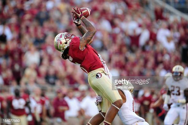 Kelvin Benjamin of the Florida State Seminoles catches a pass in front of Bryce Jones of the Boston College Eagles during a game at Doak Campbell...