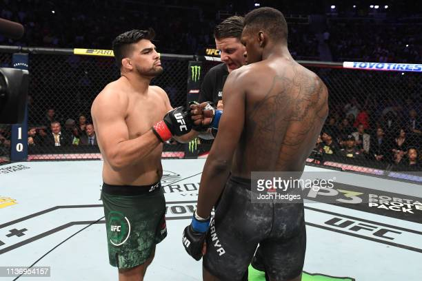 Kelvin Gastelum and Israel Adesanya touch gloves prior to their interim middleweight championship bout during the UFC 236 event at State Farm Arena...