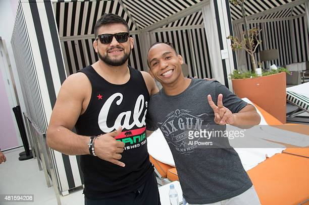 Kelvin Gastelum and John Dodson take a photo during the Foxtail pool party at SLS Las Vegas during UFC International Fight Week on July 9 2015 in Las...