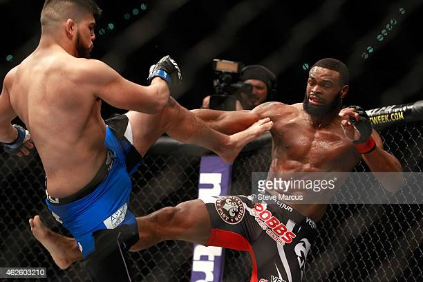 Kelvin Gastelum and Tyron Woodley kick at each other in a welterweight bout during UFC 183 at the MGM Grand Garden Arena on January 31 2015 in Las...