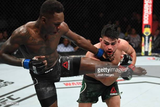 Kelvin Gastelum attempts to takedown Israel Adesanya in their interim middleweight championship bout during the UFC 236 event at State Farm Arena on...