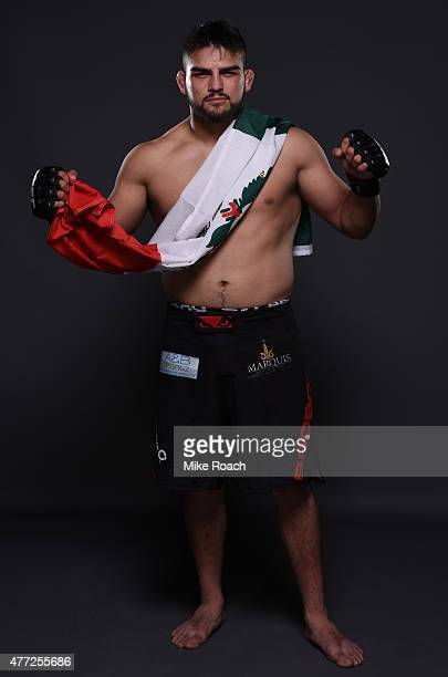 Kelvin Gastelum poses for a post fight portrait backstage during the UFC 188 event at the Arena Ciudad de Mexico on June 13 2015 in Mexico City Mexico