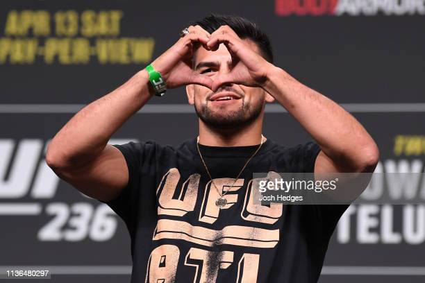 Kelvin Gastelum poses on the scale during the UFC 236 weighin at State Farm Arena on April 12 2019 in Atlanta Georgia