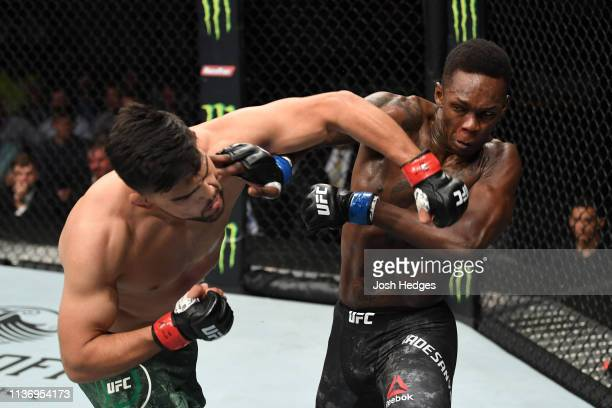 Kelvin Gastelum punches Israel Adesanya in their interim middleweight championship bout during the UFC 236 event at State Farm Arena on April 13 2019...