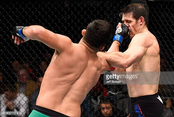 Kelvin Gastelum punches Tim Kennedy in their middleweight bout during the UFC 206 event inside the Air Canada Centre on December 10, 2016 in Toronto,...