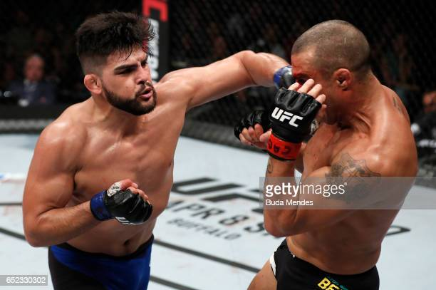 Kelvin Gastelum punches Vitor Belfort of Brazil in their middleweight bout during the UFC Fight Night event at CFO Centro de Formaco Olimpica on...