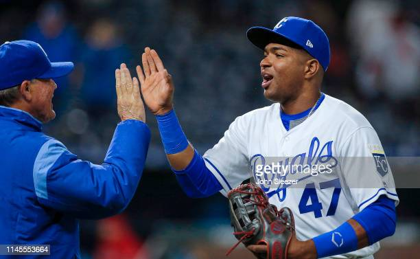 Kelvin Gutierrez of the Kansas City Royals celebrates finishing his first major league game with manager Ned Yost after the teams 94 win against the...