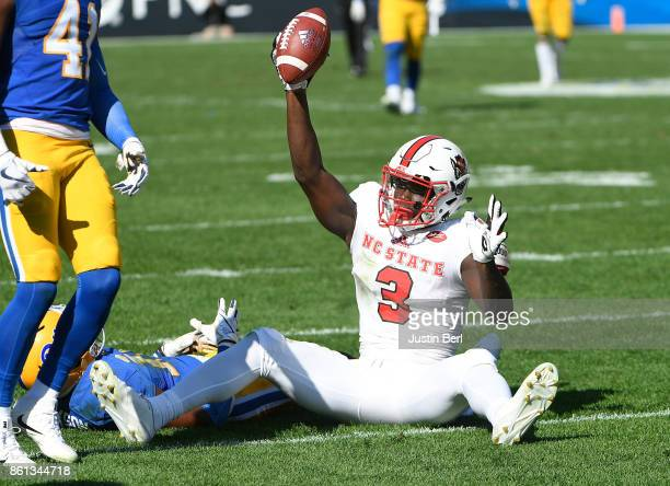 Kelvin Harmon of the North Carolina State Wolfpack reacts after a 36 yard reception on a pass from Ryan Finley in the second half during the game...