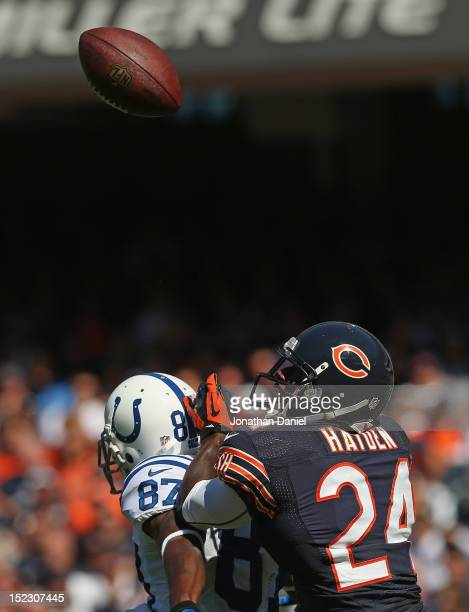 Kelvin Hayden of the Chicago Bears keeps his eyes on the ball after breaking up a pass to Reggie Wayne of the Indianapolis Colts during their 2012...